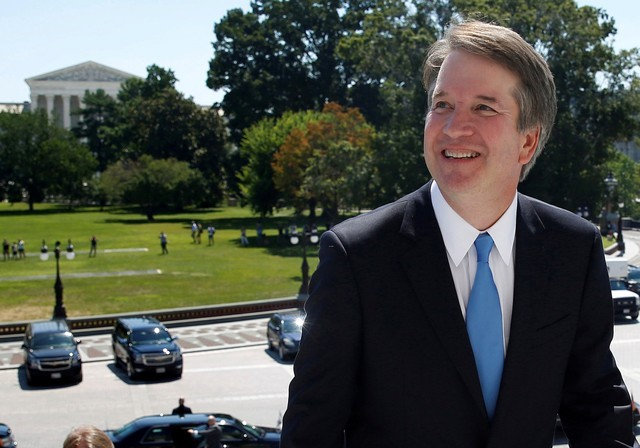 With the U.S. Supreme Court building in the background, Supreme Court nominee judge Brett Kavanaugh arrives prior to meeting with Senate Majority Leader Mitch McConnell on Capitol Hill in Washington, U.S., July 10, 2018. REUTERS/Joshua Roberts