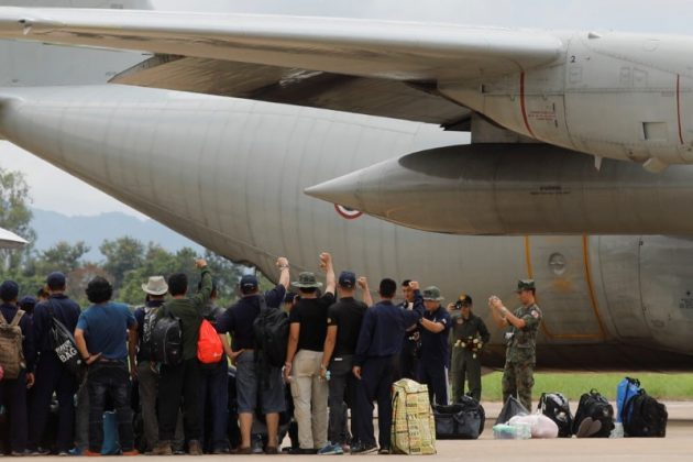 The Thai Navy pose for photo as they depart from Chiang Rai International Airport after finishing the rescue mission for 12 soccer players and their coach in Chiang Rai, Thailand July 12, 2018. REUTERS/Tyrone Siu