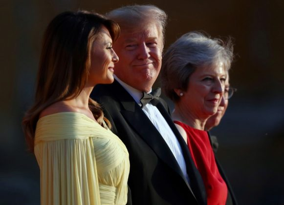 British Prime Minster Theresa May and her husband Philip stand together with U.S. President Donald Trump and First Lady Melania Trump at the entrance to Blenheim Palace, where they are attending a dinner with specially invited guests and business leaders, near Oxford, Britain, July 12, 2018. REUTERS/Hannah McKay