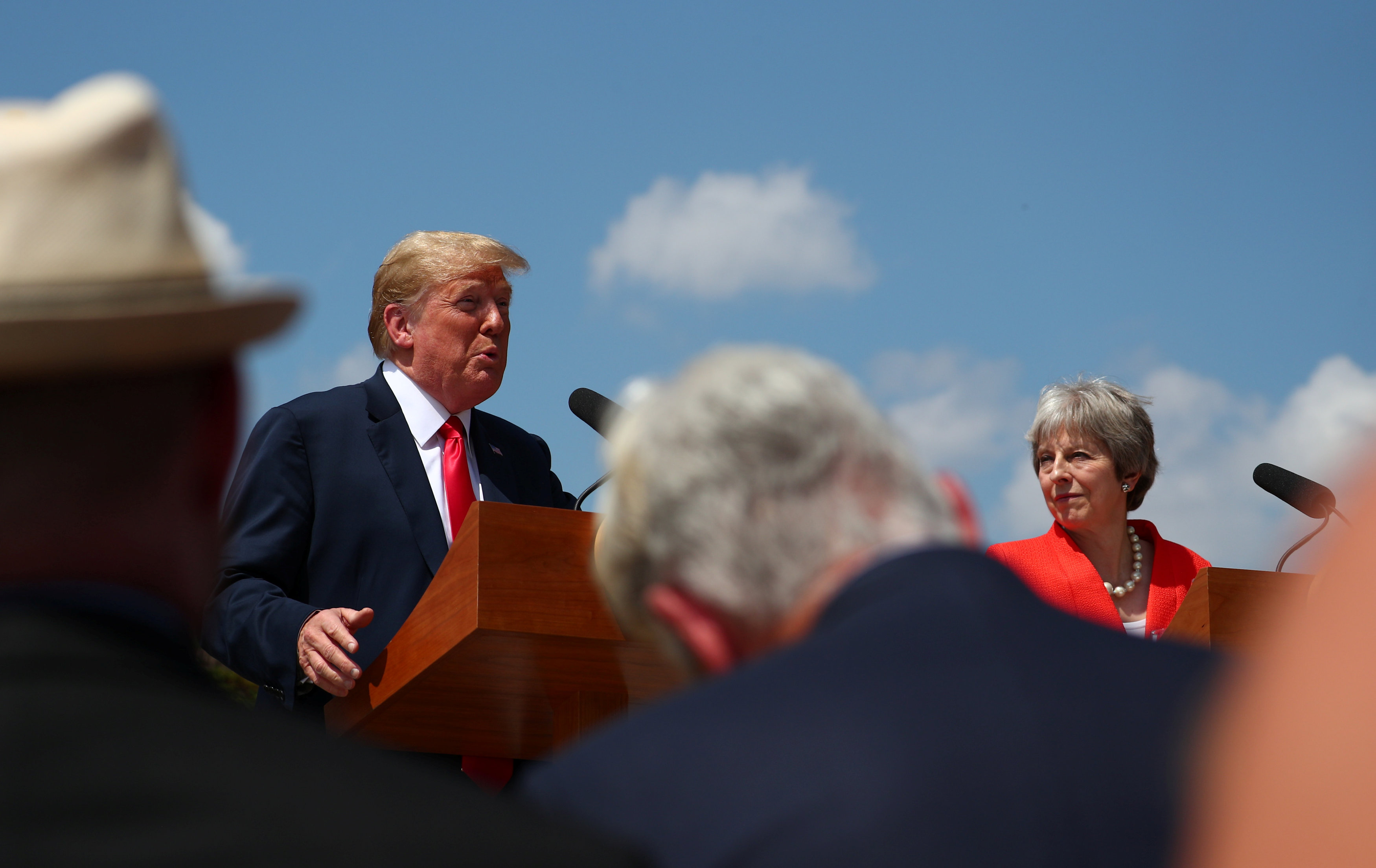 Britain's Prime Minister Theresa May and U.S. President Donald Trump hold a joint news conference at Chequers, the official country residence of the Prime Minister, near Aylesbury, Britain, July 13, 2018. REUTERS/Hannah McKay