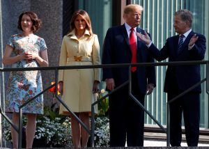 U.S. President Donald Trump, first lady Melania Trump, Finland's President Sauli Niinisto his wife Jenni Haukio pose for a photo in Helsinki, Finland, July 16, 2018. REUTERS/Kevin Lamarque