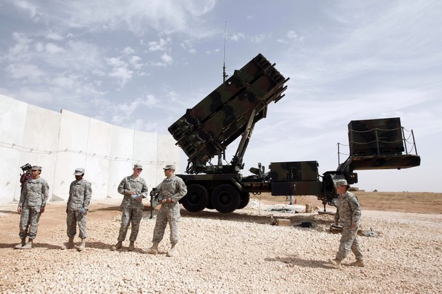FILE PHOTO: U.S. soldiers stand beside a U.S. Patriot missile system at a Turkish military base in Gaziantep, southeastern Turkey, October 10, 2014.. REUTERS/Osman Orsal