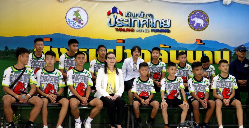 The 12 boys and their soccer coach who were rescued from a flooded cave arrive for a news conference in the northern province of Chiang Rai, Thailand, July 18, 2018. REUTERS/Soe Zeya Tun