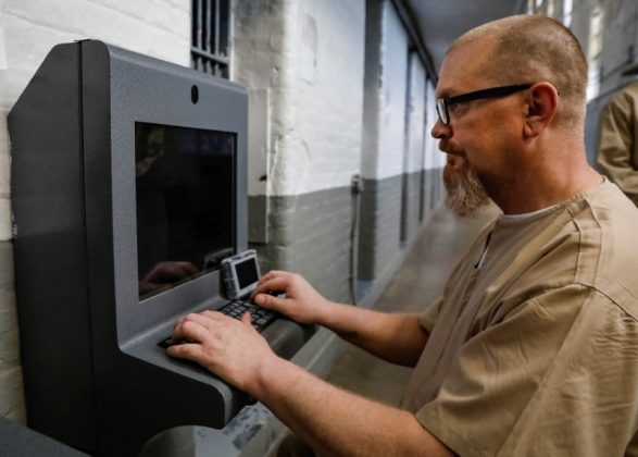 Inmate Steven Goff connects his JPay tablet device to a kiosk inside the East Jersey State Prison in Rahway, New Jersey, U.S., July 12, 2018. REUTERS/Brendan McDermid