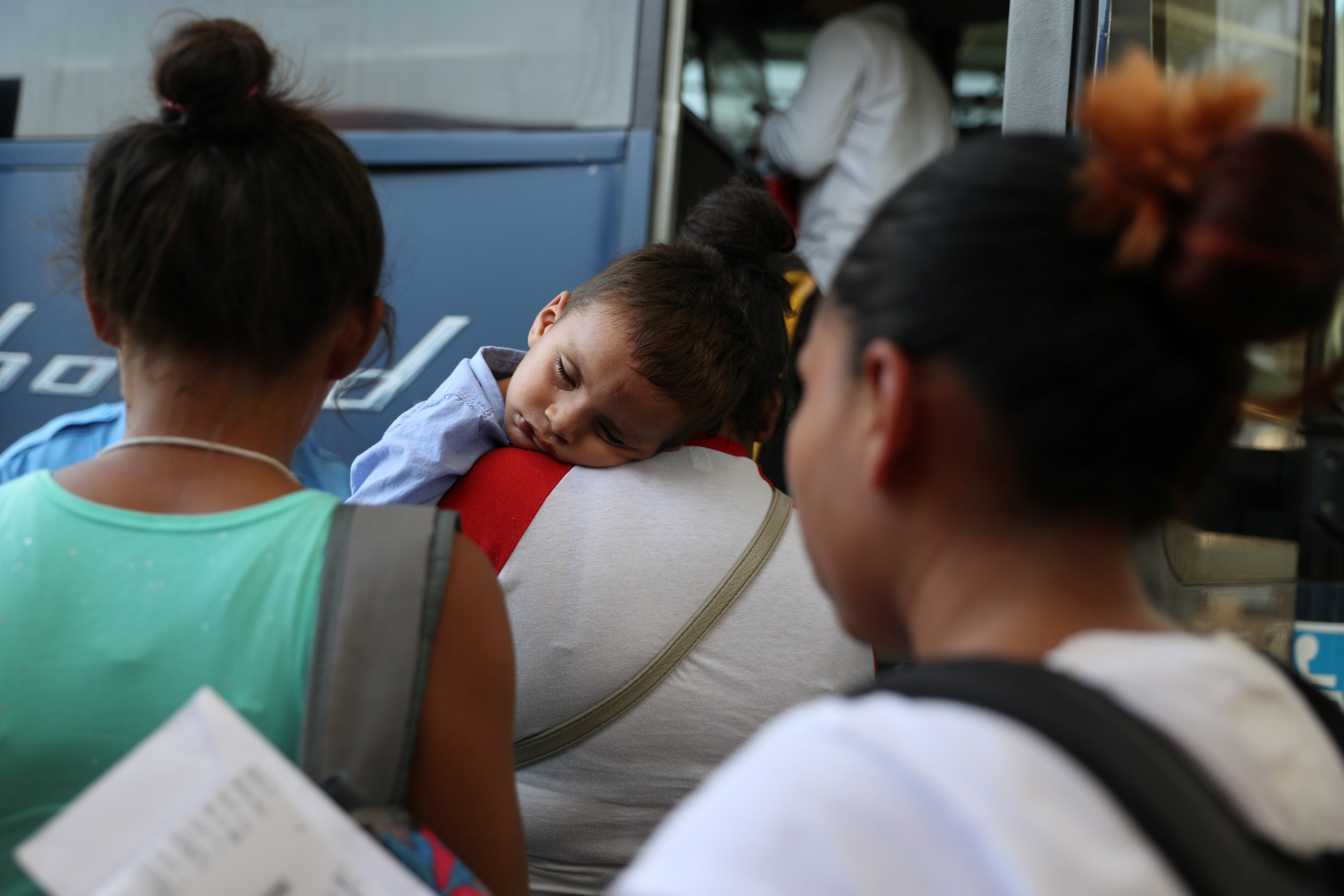 Undocumented immigrants recently released from detention prepare to depart a bus depot for cities around the country in McAllen, Texas, U.S., July 18, 2018. Picture taken July 18, 2018. REUTERS/Loren Elli