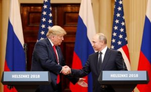 FILE PHOTO: U.S. President Donald Trump and Russian President Vladimir Putin shake hands as they hold a joint news conference after their meeting in Helsinki, Finland July 16, 2018. REUTERS/Grigory Dukor