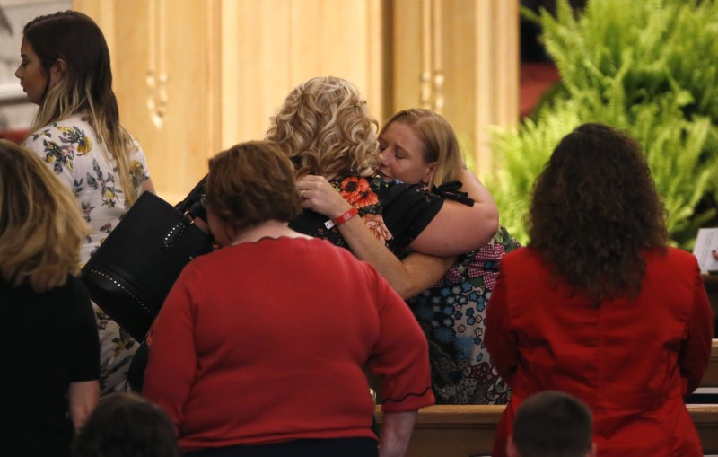 July 22, 2018; Springfield, MO, USA; Family of victims of the duck boat accident on Table Rock Lake embrace after a community wide memorial service for the families, friends and victims at College of the Ozarks in Point Lookout, Missouri on Sunday, July 22, 2018. Nathan Papes/News-Leader via USA TODAY NETWORK