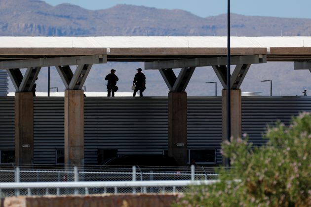 Security officers keep watch over a tent encampment housing immigrant children just north of the Mexican border in Tornillo, Texas, June 20, 2018. REUTERS/Mike