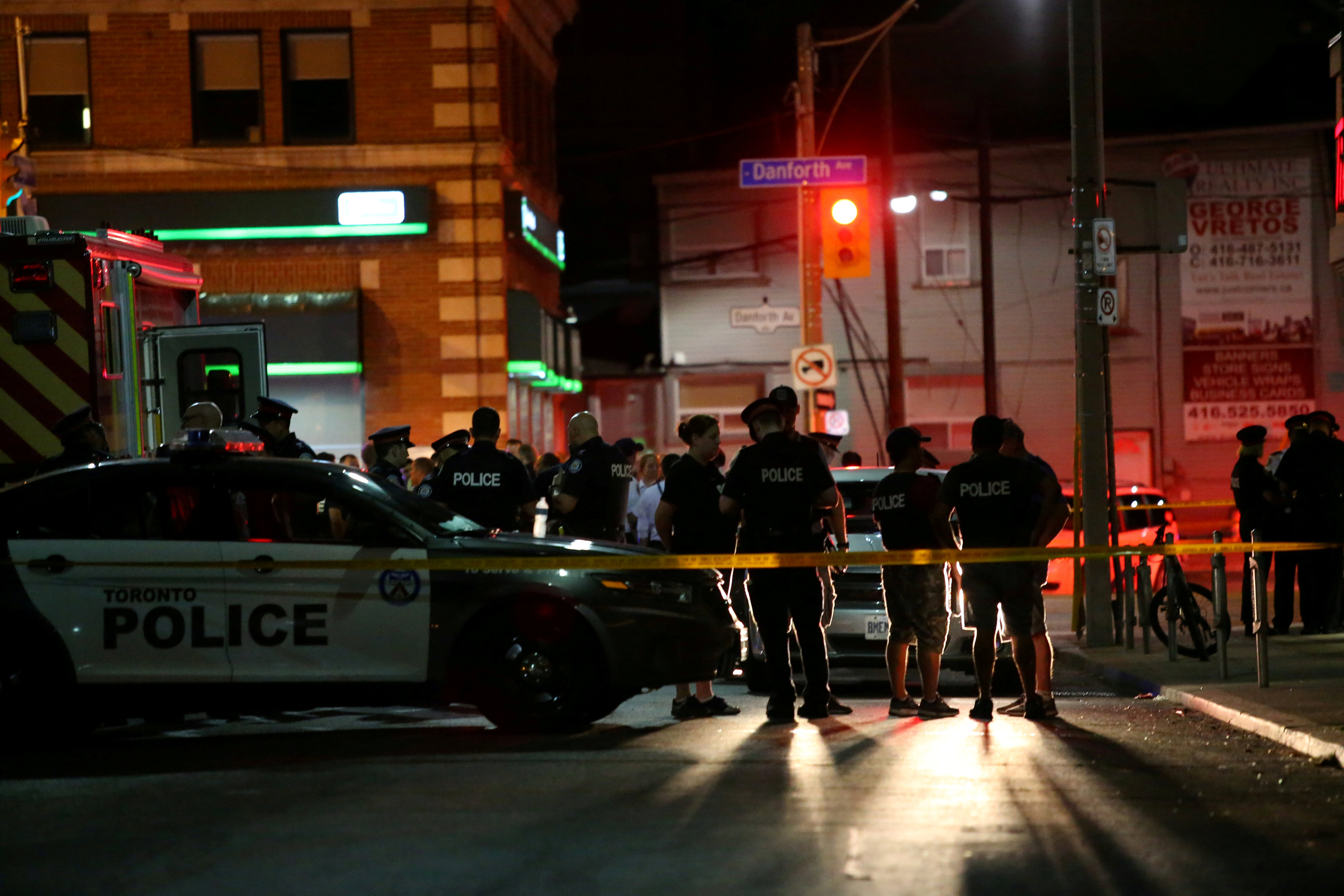 FILE PHOTO: Police are seen near the scene of a mass shooting in Toronto, Canada, July 22, 2018. REUTERS/Chris Helgr