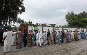 People stand in a line as they wait for a polling station to open, during general election in Rawalpindi, Pakistan July 25, 2018. REUTERS/Faisal Mahmood