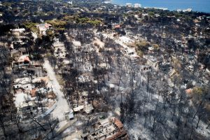 An aerial view shows burnt houses and trees following a wildfire in the village of Mati, near Athens, Greece, July 25, 2018. Antonis Nicolopoulos/Eurokinissi via REUTERS