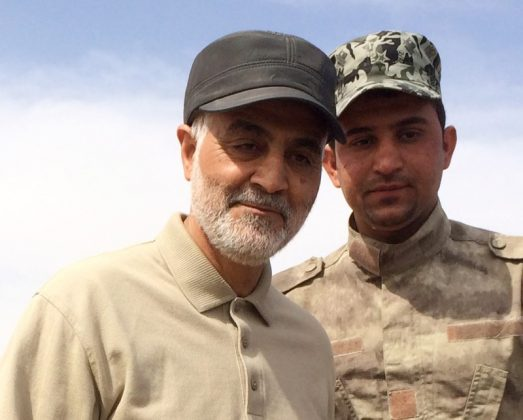 FILE PHOTO: Iranian Revolutionary Guard Commander Qassem Soleimani (L) stands at the frontline during offensive operations against Islamic State militants in the town of Tal Ksaiba in Salahuddin province March 8, 2015. REUTERS/Stringer
