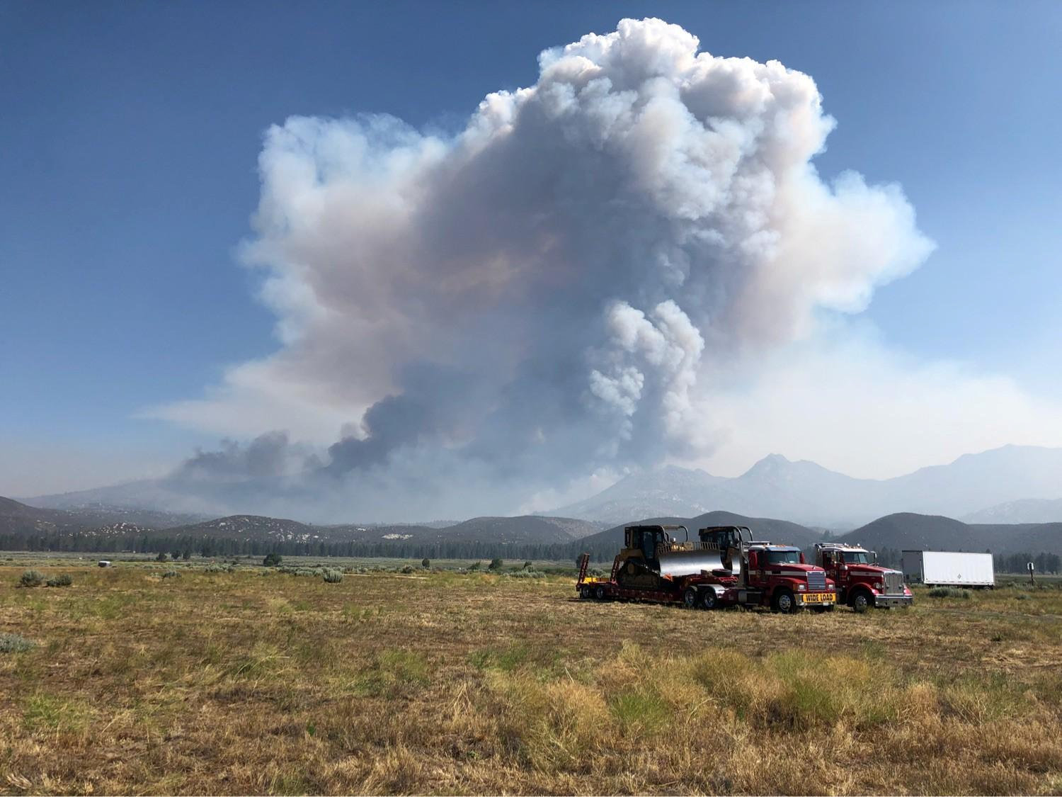 Smoke from the Cranston Fire is shown from east of Lake Hemet in Riverside County, California, U.S., July 26, 2018. USFS/Handout via REUTERS