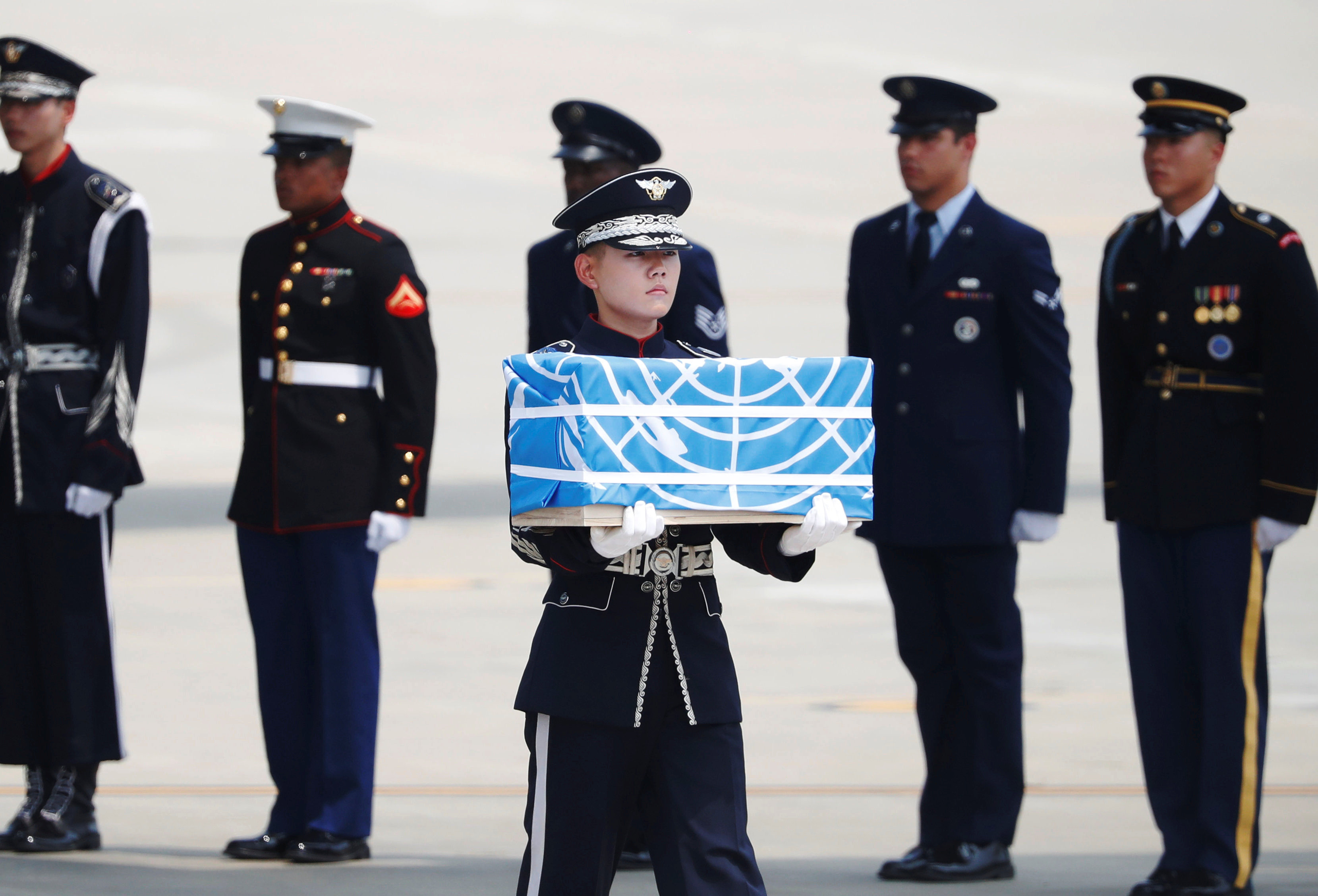 A soldier carries a casket containing the remains of a U.S. soldier who was killed in the Korean War during a ceremony at Osan Air Base in Pyeongtaek, South Korea, July 27, 2018. REUTERS/Kim Hong-Ji/Pool