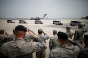 U.S. soldiers salute to vehicles transporting the remains of 55 U.S. soldiers who were killed in the Korean War at Osan Air Base in Pyeongtaek, South Korea, July 27, 2018. REUTERS/Kim Hong-Ji/Pool