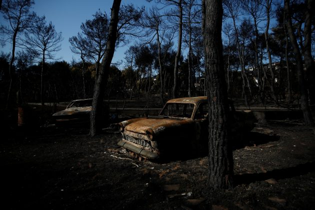 Burnt cars are seen following a wildfire in the village of Mati, near Athens, Greece, July 27, 2018. REUTERS/Costas Baltas