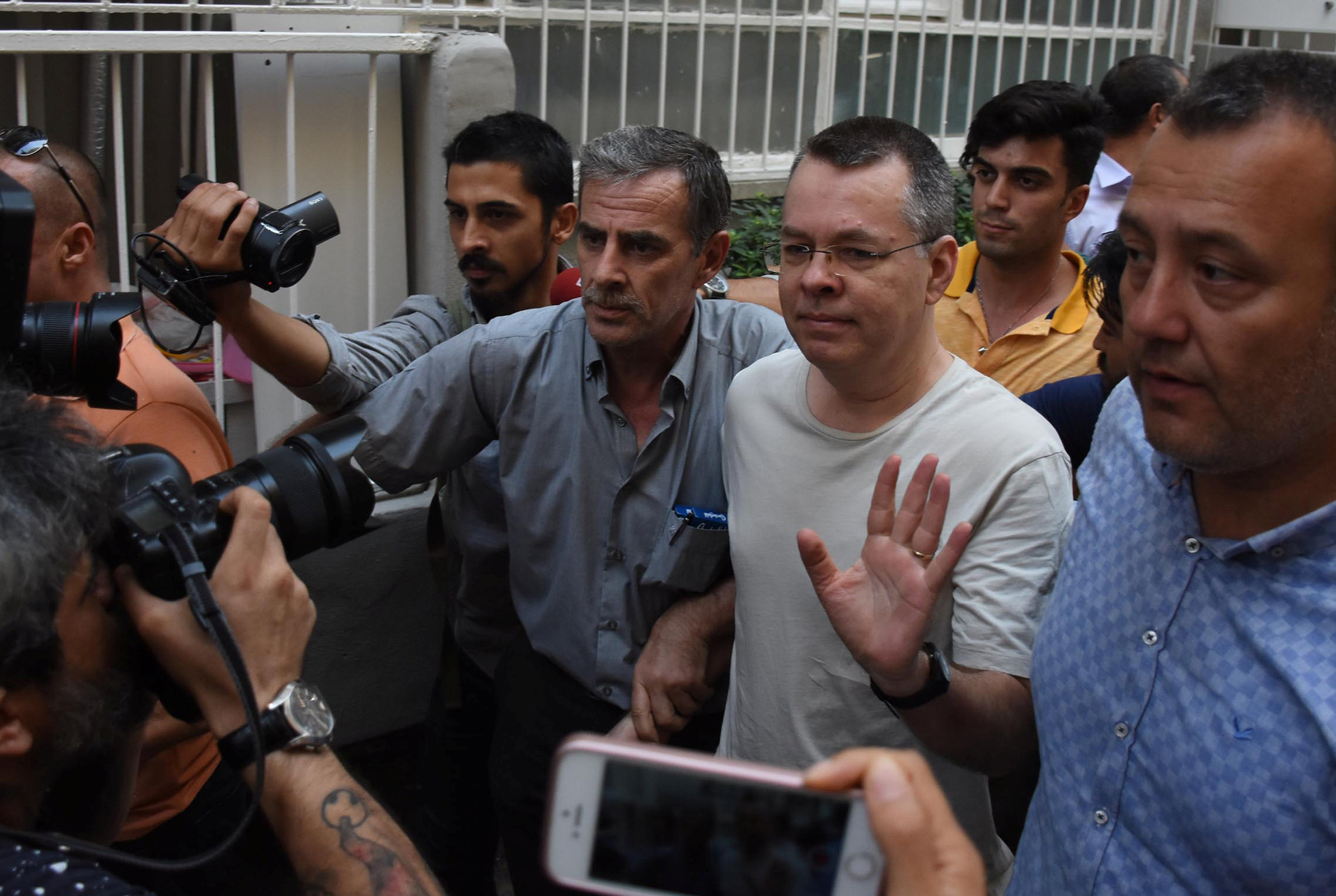 FILE PHOTO: U.S. pastor Andrew Brunson reacts as he arrives at his home after being released from the prison in Izmir, Turkey July 25, 2018. Demiroren News Agency, DHA via REUTERS