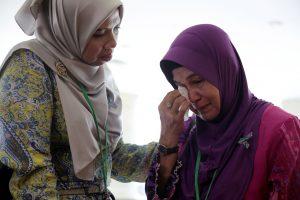 A family member cries after an MH370 closed door meeting in Putrajaya, Malaysia July 30, 2018. REUTERS/Sadiq Asyraf
