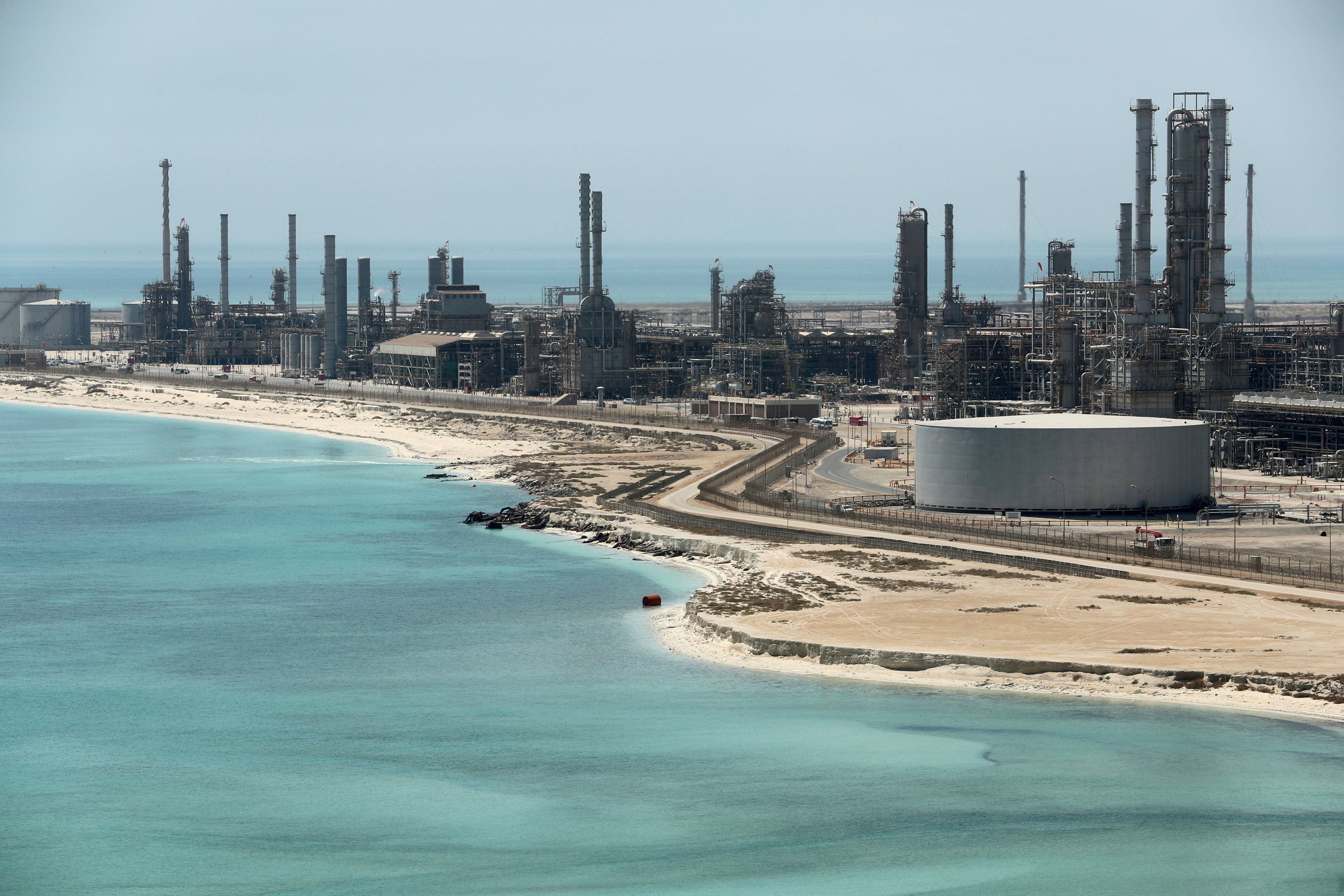 FILE PHOTO: General view of Saudi Aramco's Ras Tanura oil refinery and oil terminal in Saudi Arabia May 21, 2018. Picture taken May 21, 2018. REUTERS/Ahmed Jadallah/File Photo