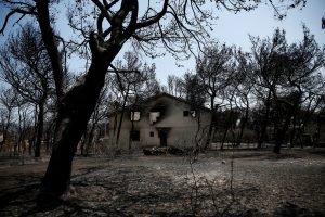 FILE PHOTO: A burnt house is seen following a wildfire in the village of Mati, near Athens, Greece, July 28, 2018. REUTERS/Costas Baltas/File Photo