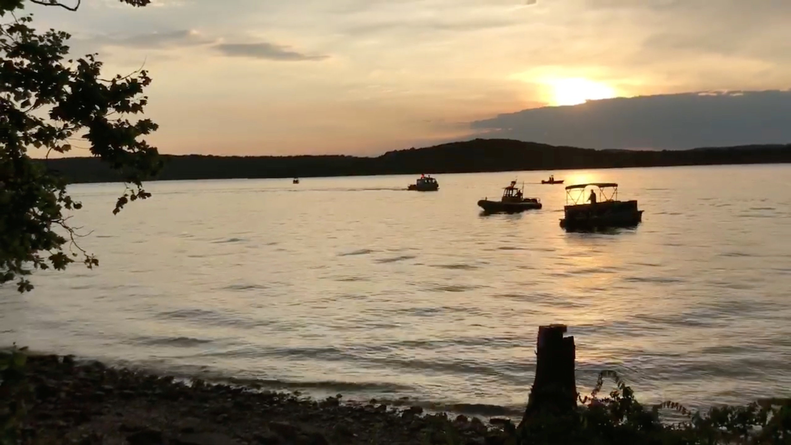 "Rescue personnel work after an amphibious ""duck boat"" capsized and sank, at Table Rock Lake near Branson, Stone County, Missouri, U.S. July 19, 2018 in this still image obtained from a video on social media. SOUTHERN STONE COUNTY FIRE PROTECTION DISTRICT/Facebook/via REUTERS"