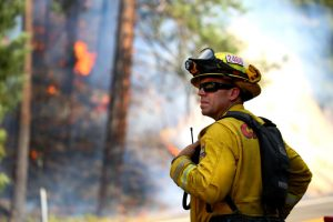 Jul 30, 2018; Redding, CA, USA; Todd Abercrombie, of Cal Fire watches the fire behavior as firefighters monitor fire movement as it crosses Highway 299 just west of Buckhorn Summit near the Trinity County line. Firefighters made progress on the fire which is now at 20 percent containment. Kelly Jordan via USA TODAY NETWORK