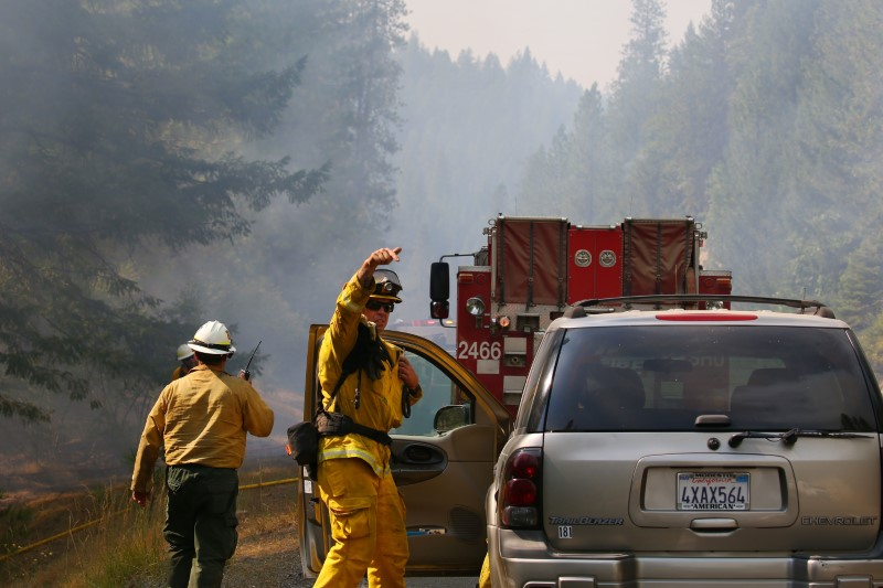Jul 30, 2018; Redding, CA, USA; Firefighters monitor fire movement as it crosses Highway 299 just west of Buckhorn Summit near the Trinity County line. Firefighters made progress on the fire which is now at 20 percent containment. Kelly Jordan via USA TODAY NETWORK