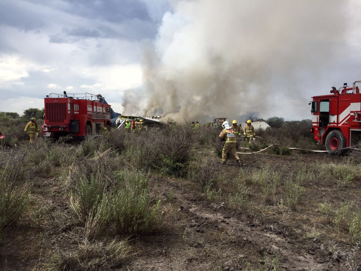 Firefigters and rescue personnel work at the site where an Aeromexico-operated Embraer passenger jet crashed in Mexico's northern state of Durango, July 31, 2018, in this picture obtained from social media. Proteccion Civil Durango/via REUTERS