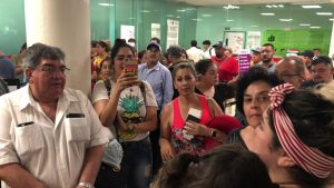 People wait in the Durango Airport after an Aeromexico-operated Embraer passenger jet crashed right after takeoff in Mexico's state of Durango, July 31, 2018, in this picture obtained from social media. Contacto Hoy/via REUTERS