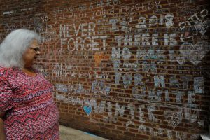 Susan Bro, mother of Heather Heyer, who was killed during the August 2018 white nationalist rally in Charlottesville, looks at the memorial and writings at the site where her daughter was killed in Charlottesville, Virginia, U.S., July 31, 2018. Picture taken July 31, 2018. REUTERS/Brian Snyder