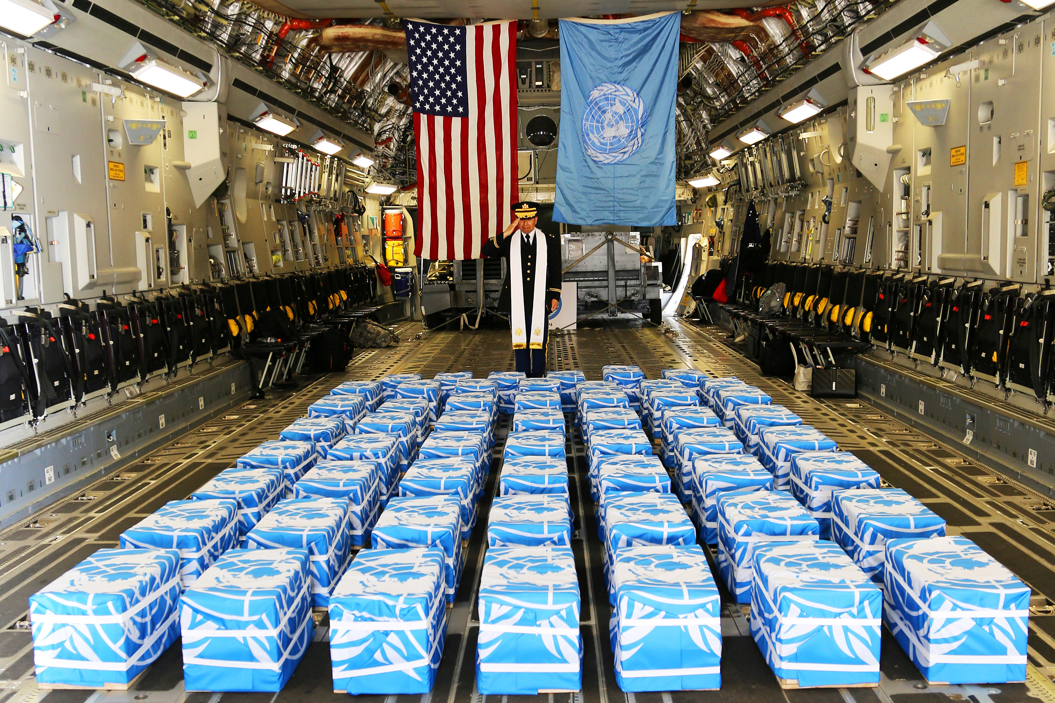 United Nations Command Chaplain U.S. Army Col. Sam Lee performs a blessing of sacrifice and remembrance on the 55 boxes of remains thought to be of U.S. soldiers killed in the 1950-53 Korean War, returned by North Korea to the U.S., at the Osan Air Base in South Korea, July 27, 2018. U.S. Army/ Sgt. Quince Lanford/Handout via REUTERS