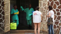 FILE PHOTO: Medecins Sans Frontieres (MSF) workers talk to a worker at an isolation facility, prepared to receive suspected Ebola cases, at the Mbandaka General Hospital, in Mbandaka, Democratic Republic of Congo May 20, 2018. REUTERS/Kenny Katombe