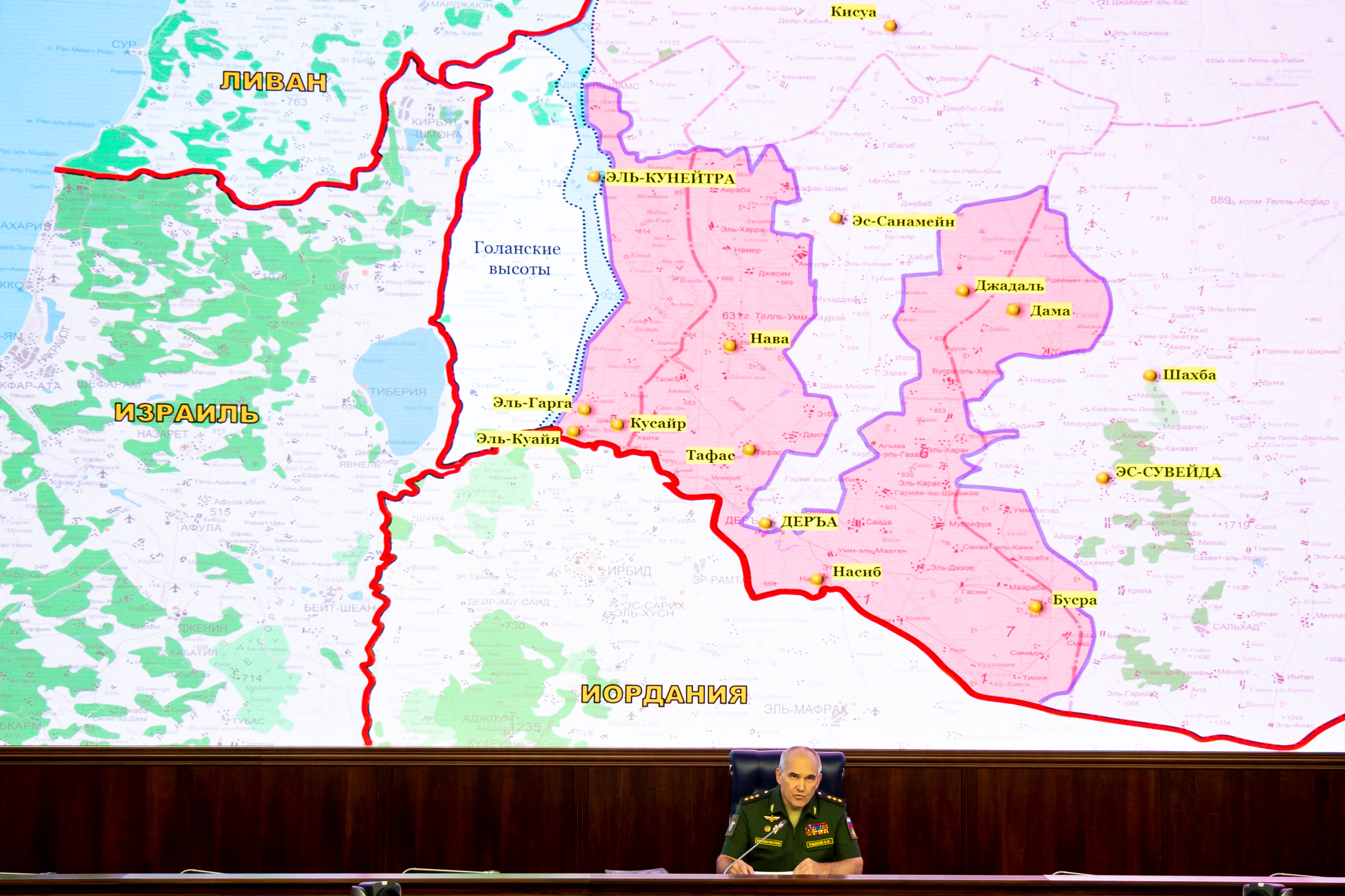 Chief of the Main Operational Directorate of the General Staff of the Russian Armed Forces Lieutenant General Sergei Rudskoi speaks during a news briefing, with a map showing the territory of Israel, Jordan, Lebanon and Syria seen in the background, in Moscow, Russia August 2, 2018. Alexander Zemlianichenko/Pool via REUTERS