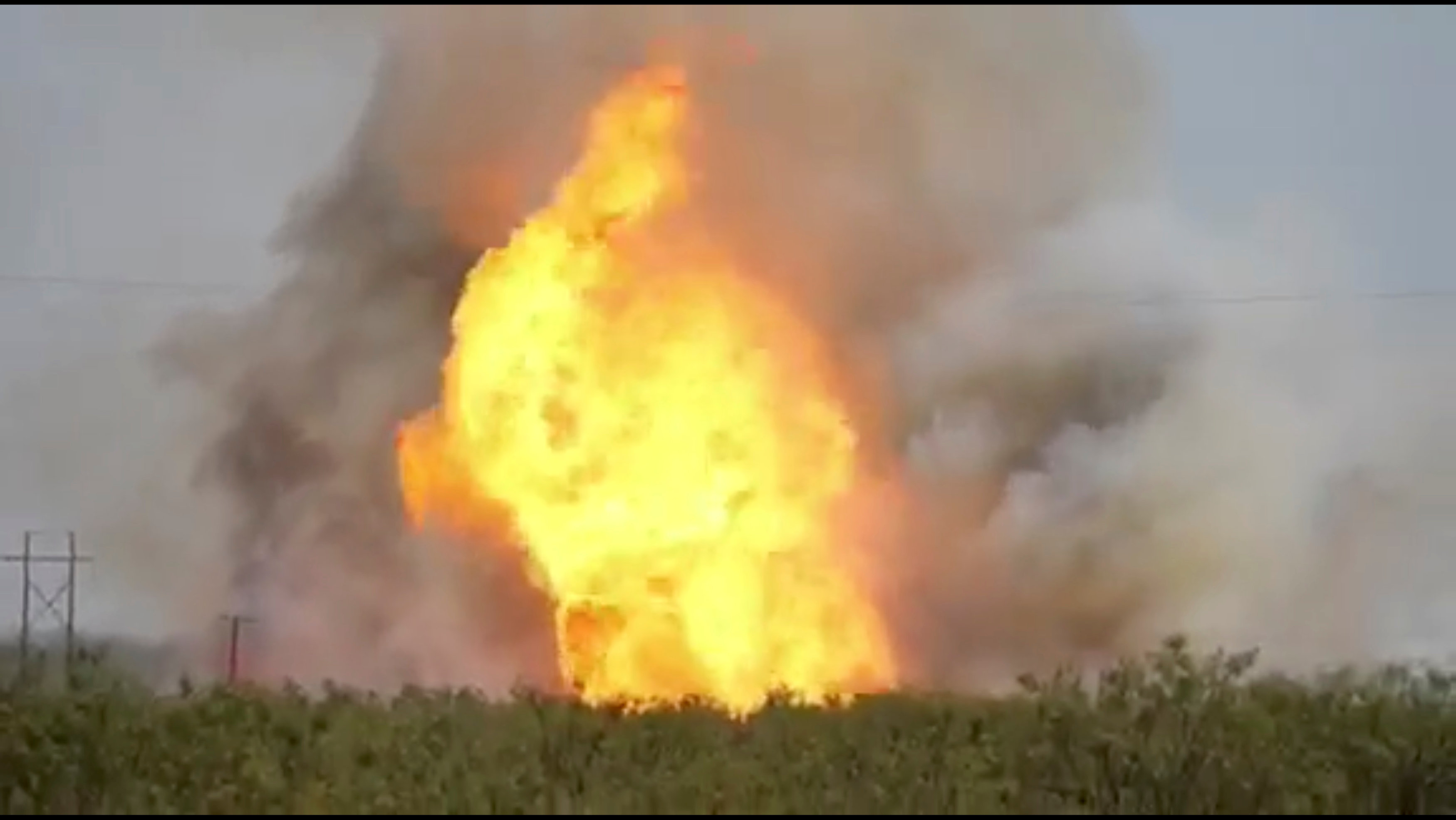 A pipeline explosion erupts in this image captured from video by a field worker in Midland County, the home to the Permian Basin and the largest U.S. oilfield, in Texas, U.S., August 1, 2018. Courtesy Marty Baeza/Handout via REUTERS