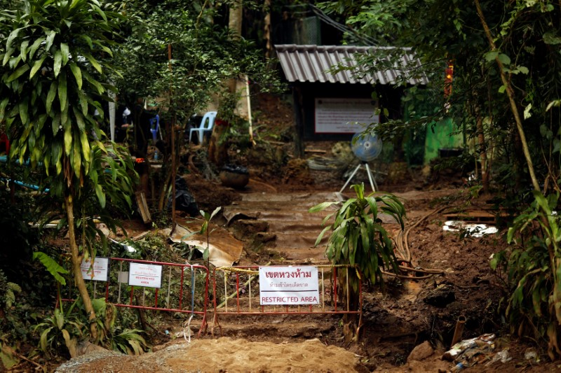 "A ""Restricted Area"" sign is seen in front of the Tham Luang cave complex, after the rescue mission for the 12 boys of the ""Wild Boars"" soccer team and their coach, in the northern province of Chiang Rai, Thailand July 14, 2018. REUTERS/Tyrone Siu/File Photo"