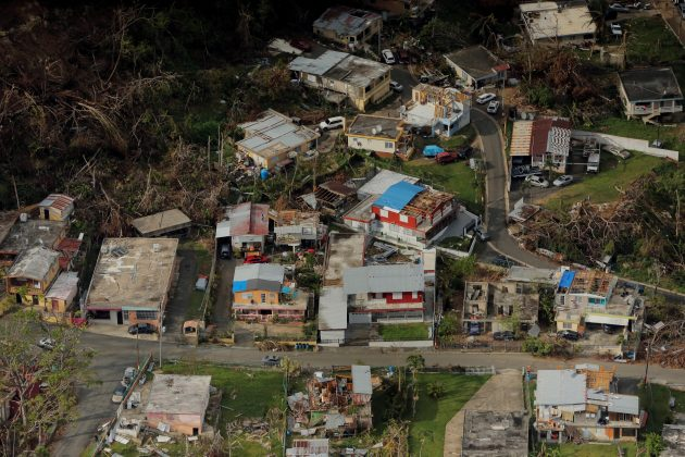 FILE PHOTO: Buildings damaged by Hurricane Maria are seen in Lares, Puerto Rico, October 6, 2017. REUTERS/Lucas Jackson/File Photo