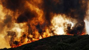 Wind-driven flames roll over a hill towards homes during the River Fire (Mendocino Complex) near Lakeport, California, U.S. August 2, 2018. REUTERS/Fred Greaves