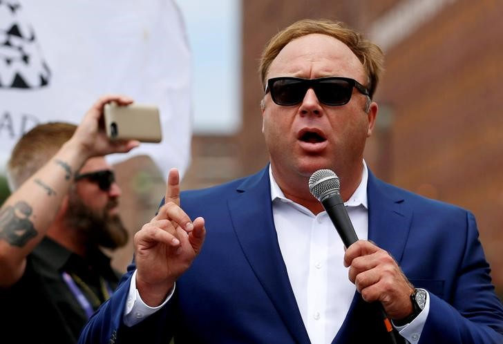 FILE PHOTO: Alex Jones from Infowars.com speaks during a rally in support of Republican presidential candidate Donald Trump near the Republican National Convention in Cleveland, Ohio, U.S., July 18, 2016. REUTERS/Lucas Jackson/File Photo
