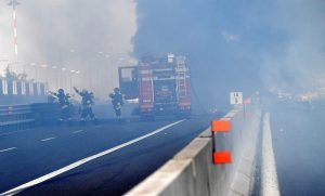 Firefighters work on the motorway after an accident caused a large explosion and fire at Borgo Panigale, on the outskirts of Bologna, Italy, August 6, 2018. REUTERS/Stringer