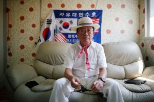 Vietnam War veteran Chung Seung-jin poses for photographs after an interview with Reuters at his home in Suwon, South Korea, July 31, 2018. REUTERS/Kim Hong-Ji