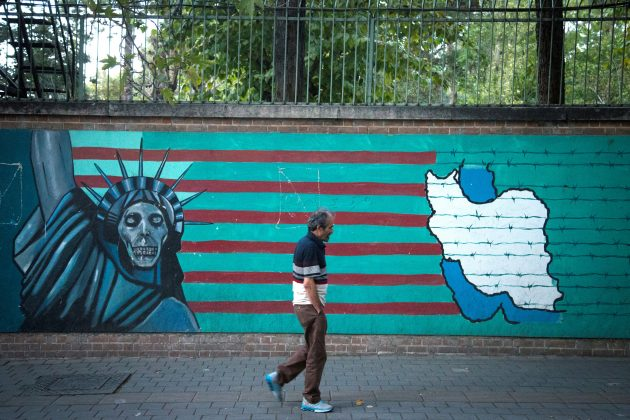 FILE PHOTO: A man walks past an anti-U.S. mural in Tehran, Iran October 13, 2017. Nazanin Tabatabaee Yazdi/TIMA via REUTERS