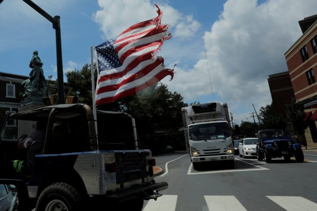 A U.S. flag flies from the back of a car, ahead the one-year anniversary of the fatal white-nationalist rally, in Charlottesville, Virginia, U.S., August 1, 2018. REUTERS/Brian Snyder