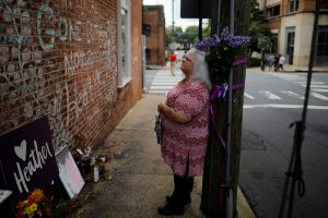 Susan Bro, mother of Heather Heyer, who was killed during the August 2017 white nationalist rally in Charlottesville, stands at the memorial at the site where her daughter was killed in Charlottesville, Virginia, U.S., July 31, 2018. REUTERS/Brian Snyder