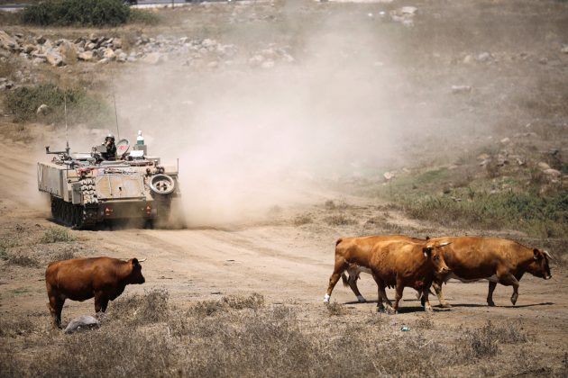An Israeli soldier rides an armoured vehicle during an army drill after the visit of Israeli Defence Minister Avigdor Lieberman in the Israeli-occupied Golan Heights, Israel August 7, 2018. REUTERS/Amir Cohe