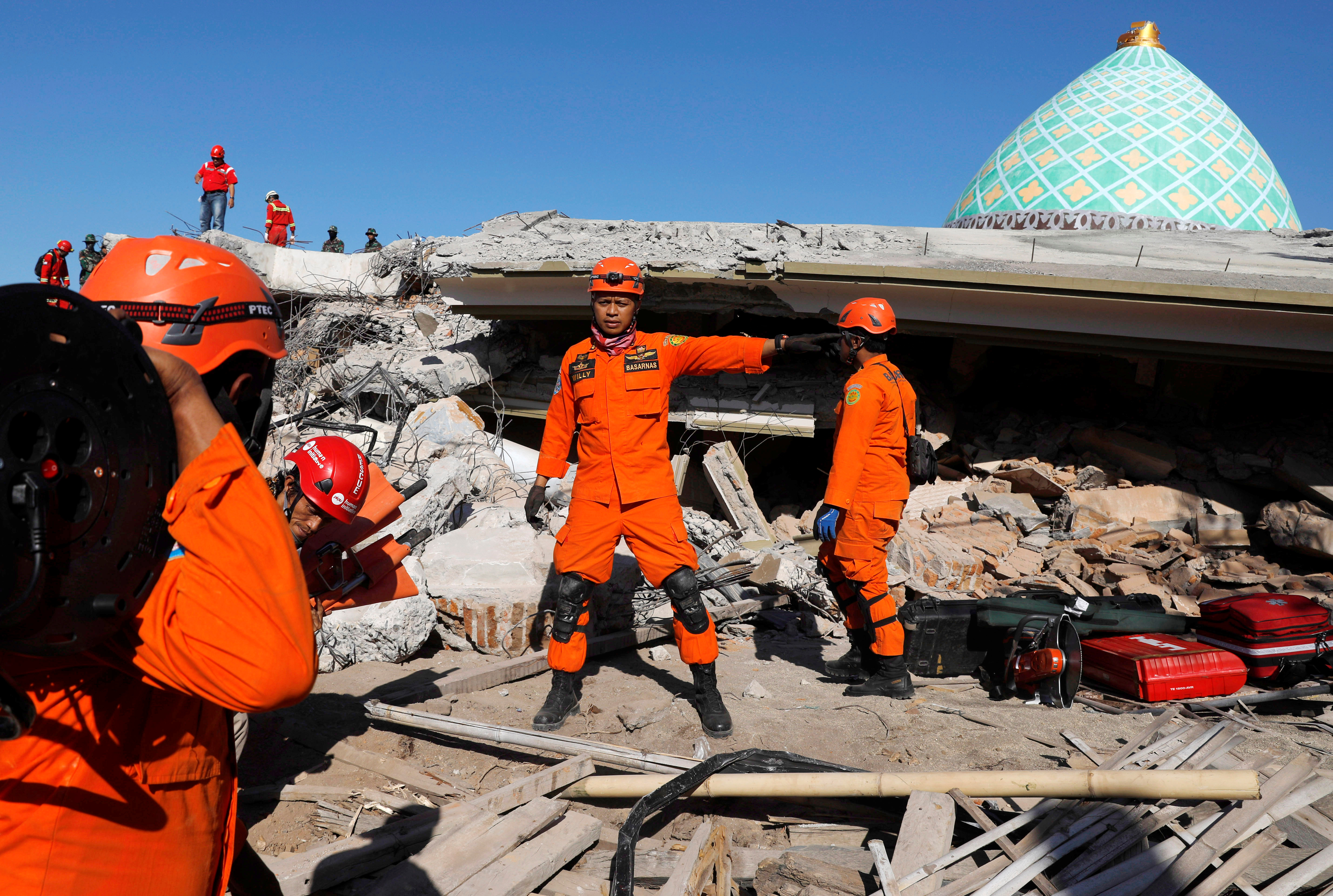 Rescue team members prepare to find people trapped inside a mosque after an earthquake hit on Sunday in Pemenang, Lombok Island, Indonesia, August 8, 2018. REUTERS/Beawiharta