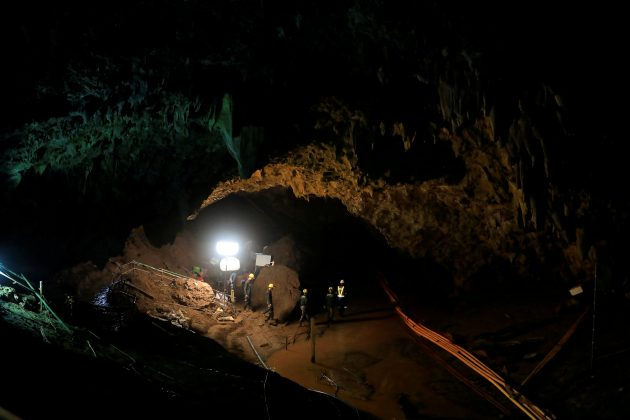 FILE PHOTO: Rescue workers at the Tham Luang cave complex in Thailand on, July 10, 2018, the day 12 boys were rescued after nine days trapped in the caves. REUTERS/Soe Zeya Tun/File Photo