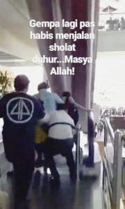 People are seen running out of Bali's Ngurah Rai International Airport, Indonesia August 9, 2018 in this still image taken from a video obtained from social media. DOY SAFANDO BALI/via REUTERS