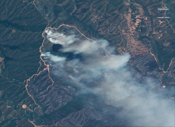 A satellite image shows the River fire at the Mendocino Complex wildfire in California, U.S., August 6, 2018. Picture taken on August 6, 2018. Satellite image ©2018 DigitalGlobe, a Maxar company/Handout via REUTERS