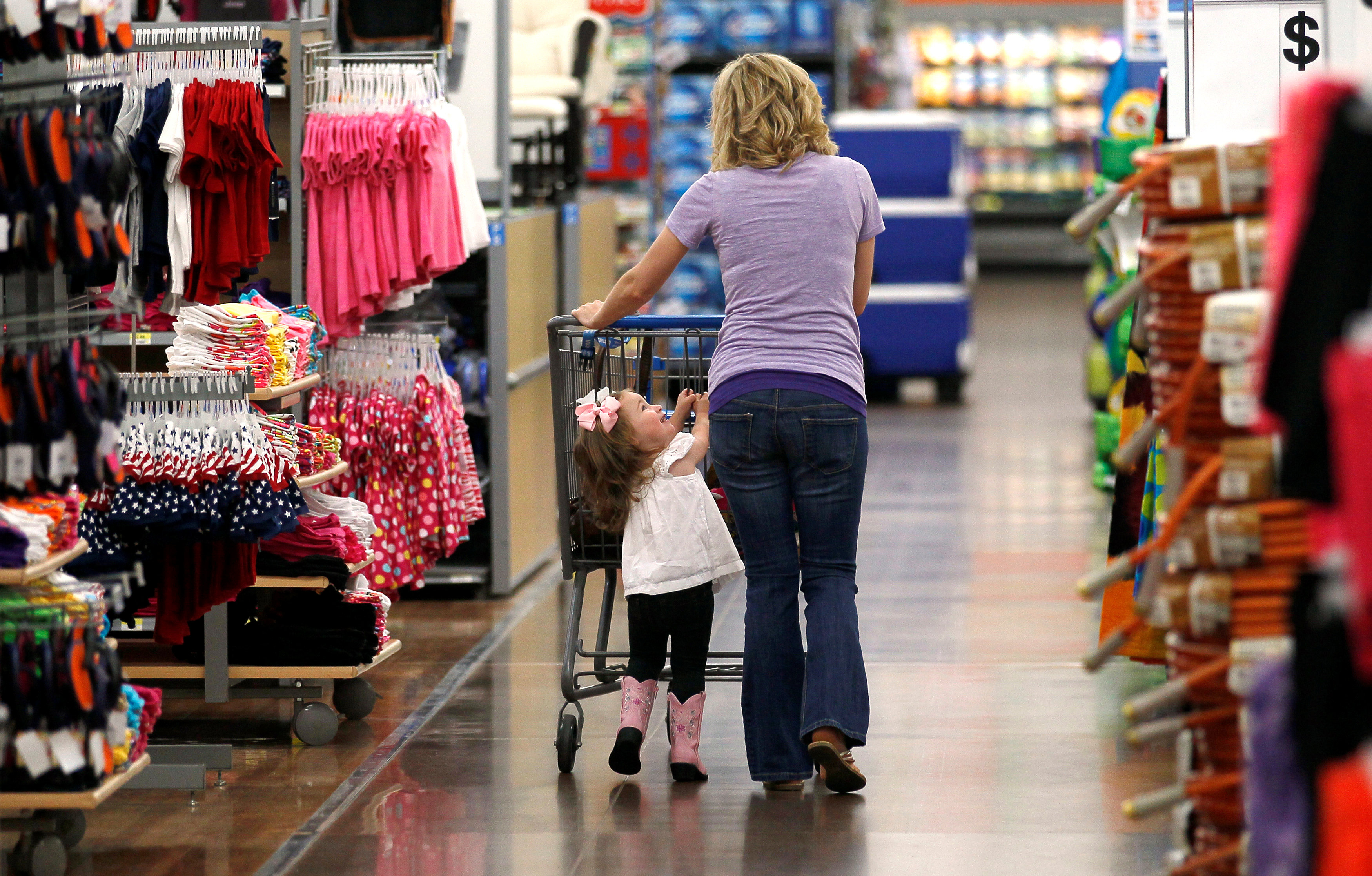 FILE PHOTO: A woman shops with her daughter at a Walmart Supercenter in Rogers, Arkansas, U.S., June 6, 2013. REUTERS/Rick Wilking/File Phot