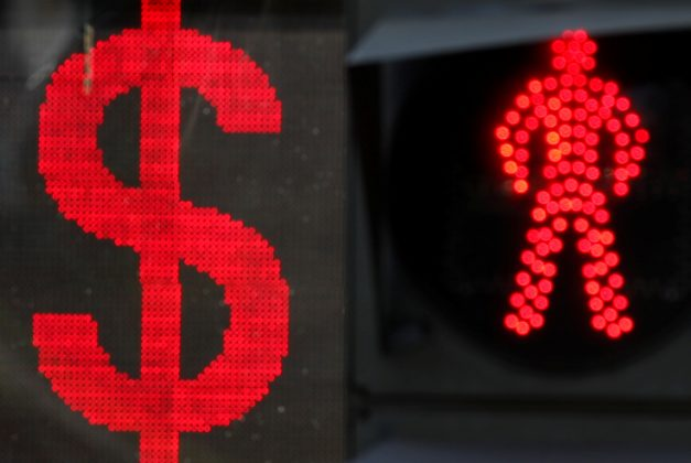 The U.S. dollar sign is seen on an electronic board next to a traffic light in Moscow, Russia August 10, 2018. REUTERS/Maxim Shemetov